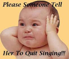 Please Someone Tell Her To Quit Singing!!!