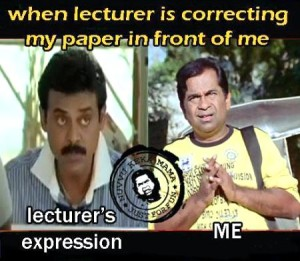 Lecturer Correcting Paper In Front Of Me