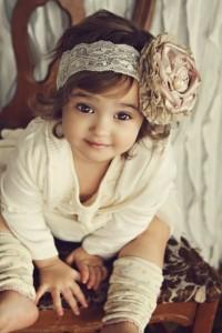 Cute Baby Girl In Cream Dress